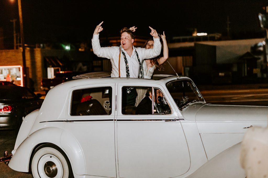 Getaway car after Wedding Reception at Brake and Clutch Warehouse in Dallas Texas