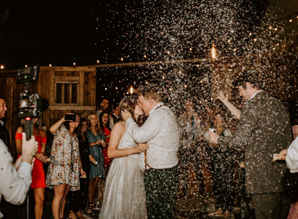 Confetti Exit after Wedding Reception at Brake and Clutch Warehouse in Dallas Texastch Warehouse in Dallas Texas